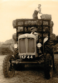Health and Safety? Grandad smoking on the hay trailer!
